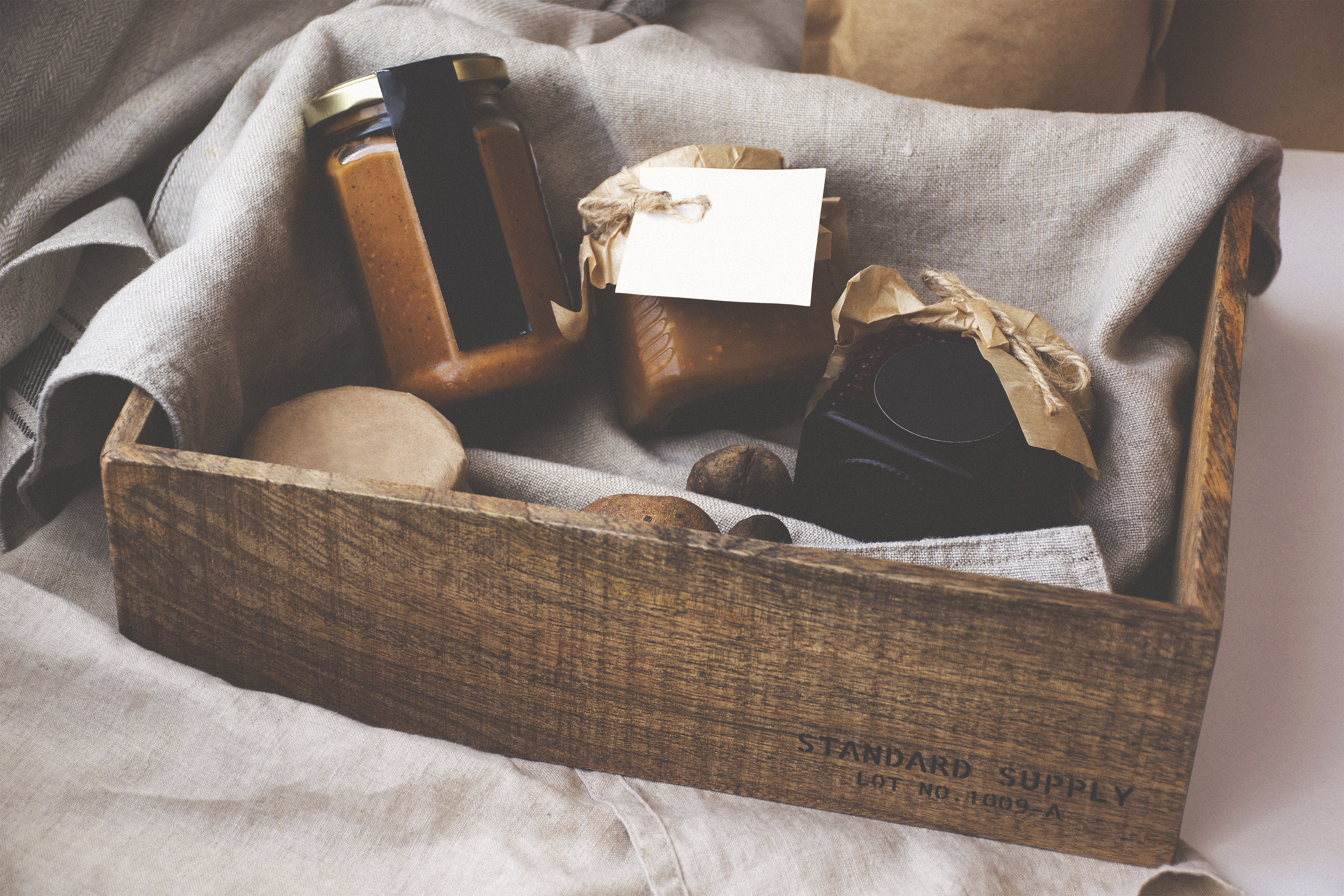 Altitude media package products wooden box filled with perishable foods and jars
